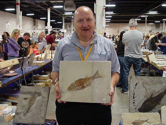 professor Russell with fish fossil
